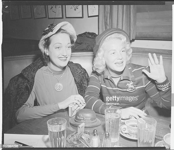 Hollywood Newsreel A pair of Hollywood thrushes smile greetings at the Brown Derby Dottie Lamour and Betty Hutton were probably comparing notes...
