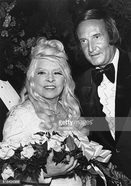 Making her first appearance at a live TV event in 12 years actress Mae West is greeted by Don Kirshner as she arrives for the 2nd annual Rock Music...