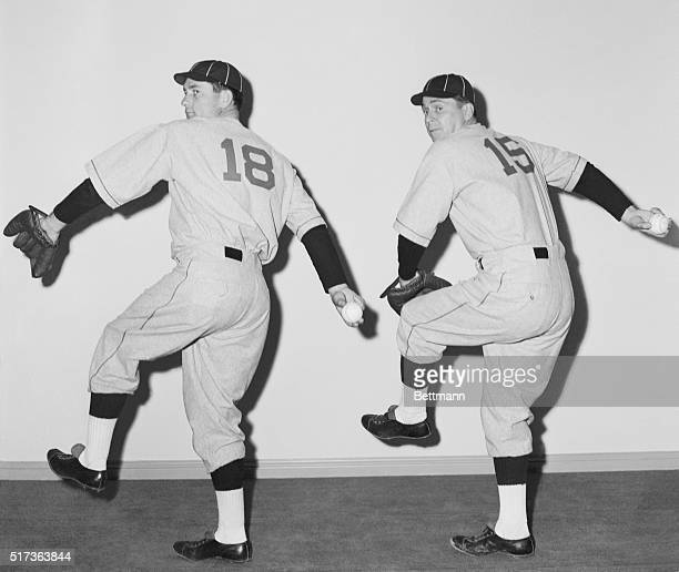 Pitching For Pictures Bob Lemon star hurler of the Cleveland Indians goes through some mound paces with actor Ronald Reagan who'll play the famed...