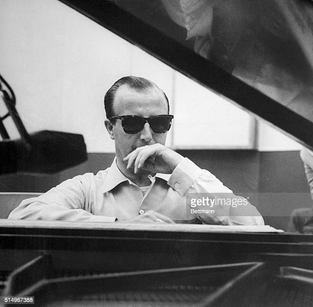 To put the symphony concert people in a better way to pay their bills jazz pianist George Shearing thinks that combining jazz and the classics on the...