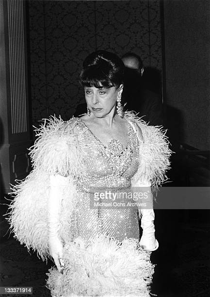 Hollywood costume designer Edith Head poses for a portrait at home circa 1975 in Los Angeles California