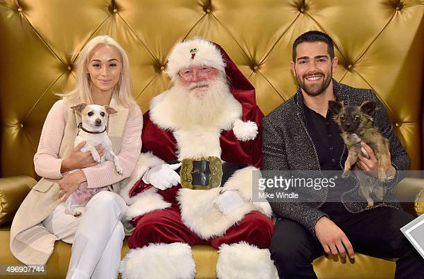 Hollywood couple Jesse Metcalfe Cara Santana and their pups Shepherd and Dexter pose for the first 'Pet Portrait with Santa' of the season at the...
