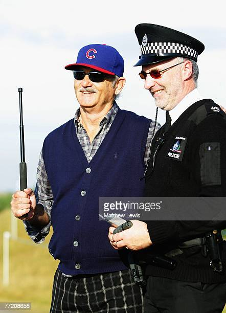 Hollywood film actor Bill Murray shares a joke with a local policeman during the third round of The Alfred Dunhill Links Championship at Kingsbarns...