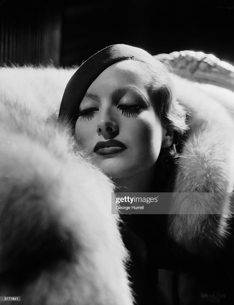 Hollywood film actress Joan Crawford (1908 - 1977) plays the title role in film director Clarence Brown's drama 'Letty Lynton'. Costumes by Adrian.