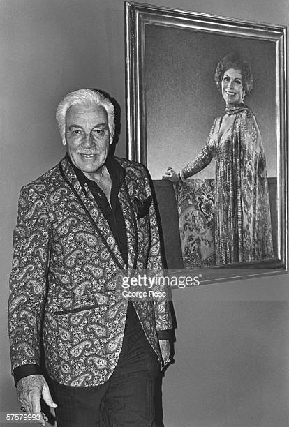 Hollywood film and TV actor Cesar Romero poses in the foyer of his home in Beverly Hills California Romero was perhaps best known for his role as The...