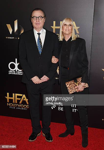 Hollywood Film Festival founder Carlos de Abreu and Janice Pennington De Abreu arrive at the 20th Annual Hollywood Film Awards at The Beverly Hilton...