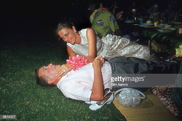 Hollywood film producer Leland Hayward shares a tender moment with his wife Slim at a party held in Honolulu for the cast of the film 'Mister...