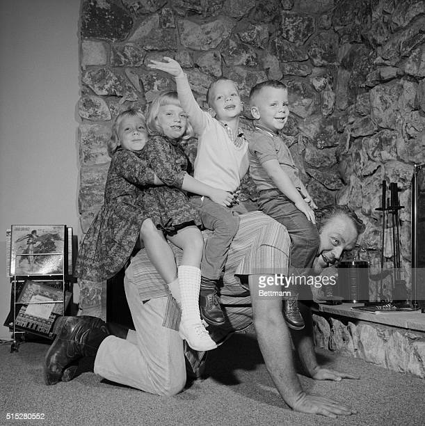 Giddap And Go Riding daddyback the four children of TV actor Dan Blocker have a willing steed under them during a romp at home in Hollywood Blocker...