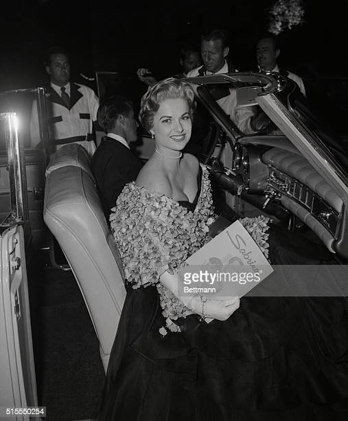 Hollywood glamour girl Martha Hyer came close to stealing the spotlight at the World Premiere at the Hollywood Paramount theatre last night of...