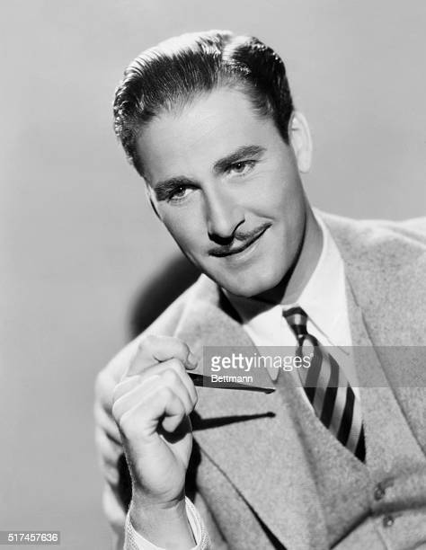 Hollywood glamour style of actor Errol Flynn with pipe