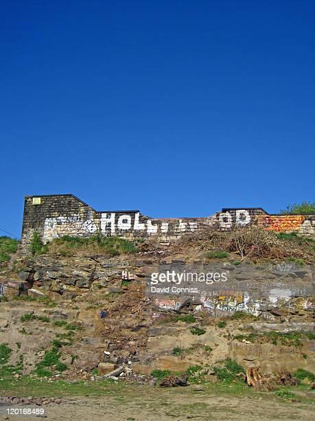 Hollywood graffiti on stone wall