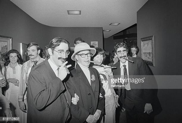 Groucho Marx's companion Erin Fleming gags it up with a cigar as she tries to find the 'real Groucho' among the lookalikes that came to the...