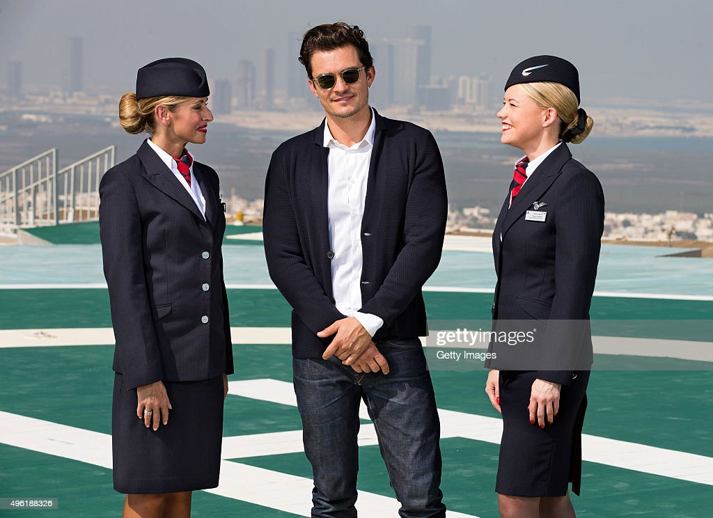 Hollywood hotshot Orlando Bloom (C) surveys the sweeping Abu Dhabi cityscape from an inner-city helipad during a visit to celebrate the launch of the new British Airways Boeing 787-9 Dreamliner's daily London-Abu Dhabi-Muscat service. The British heartthrob, 38, was accompanied by two female members of the airline's crew in the UAE capital for the stylish shoot to mark the aircraft's introduction to British Airways' fleet on November 6, 2015 in Abu Dhabi, United Arab Emirates.