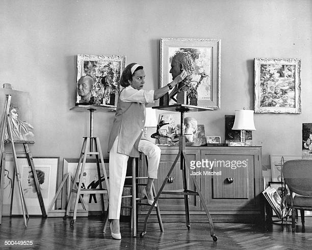 Hollywood Icon Gloria Swanson works on sculpture one of her favorite pastimes in her Manhattan home in 1965