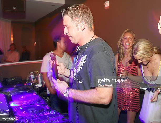 LAS VEGAS JULY 13 DJ Hollywood Lindsay Lohan and an unidentified guest attend Saturday Evening at PURE Nightclub on July 14 2007 in Las Vegas Nevada
