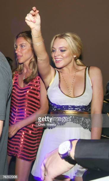 LAS VEGAS NEVADA JULY 14 DJ Hollywood Lindsay Lohan and unidentified guests attend Saturday Evening at PURE Nightclub on July 14 2007 in Las Vegas...