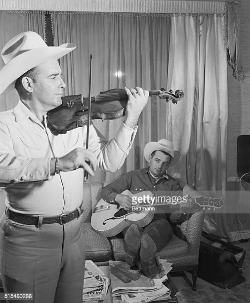 Hollywood, Los Angeles, California: Cowboy band leader Bob Wills and his vocalist and guitarist, Tommy Duncan, do a little impromptu cowboy jiving at...
