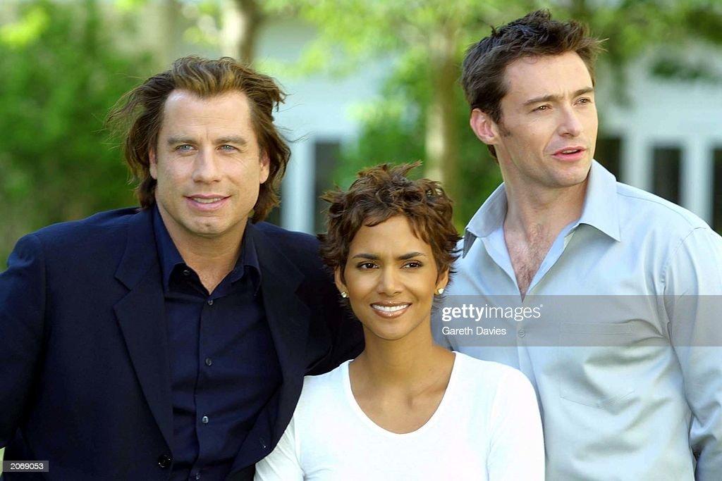 John Travolta, Halle Berry and Hugh Jackman in London to promote their new movie Swordfish : News Photo