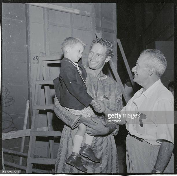 Hollywood Newsreel Rome Italy A chip off the old block three year old Fraser Heston shakes hands with movie director William Wyler in Rome The...