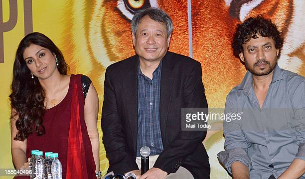 Hollywood Oscar winning director Ang Lee flanked by Indian Bollywood actress Tabu and actor Irfan Khan during a press meet for the forthcoming...