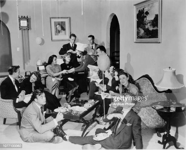 A Hollywood party hosted by actress Ann Blyth and attended by Scott Brady Mel Tormé Susan Perry Elizabeth Taylor Jane Powell Douglas Dick Arthur Loew...