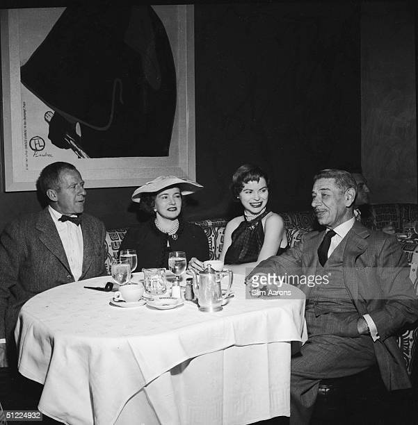 Hollywood photographer John Swope with his wife actress Dorothy Maguire and restaurateur Mike Romanoff at Romanoffs Restaurant in Beverly Hills circa...