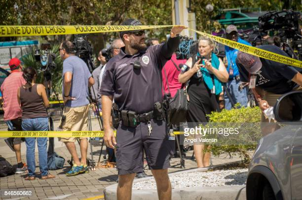Hollywood Police Department officers direct traffic outside a perimeter surrounding a rehabilitation center where six patients were found dead...