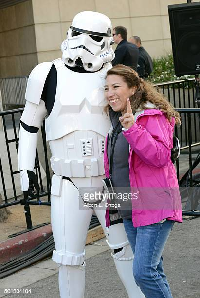 Hollywood Prepares For The Premiere Of Walt Disney Pictures And Lucasfilm's Star Wars The Force Awakens A Storm Trooper poses with a fan on the 2nd...