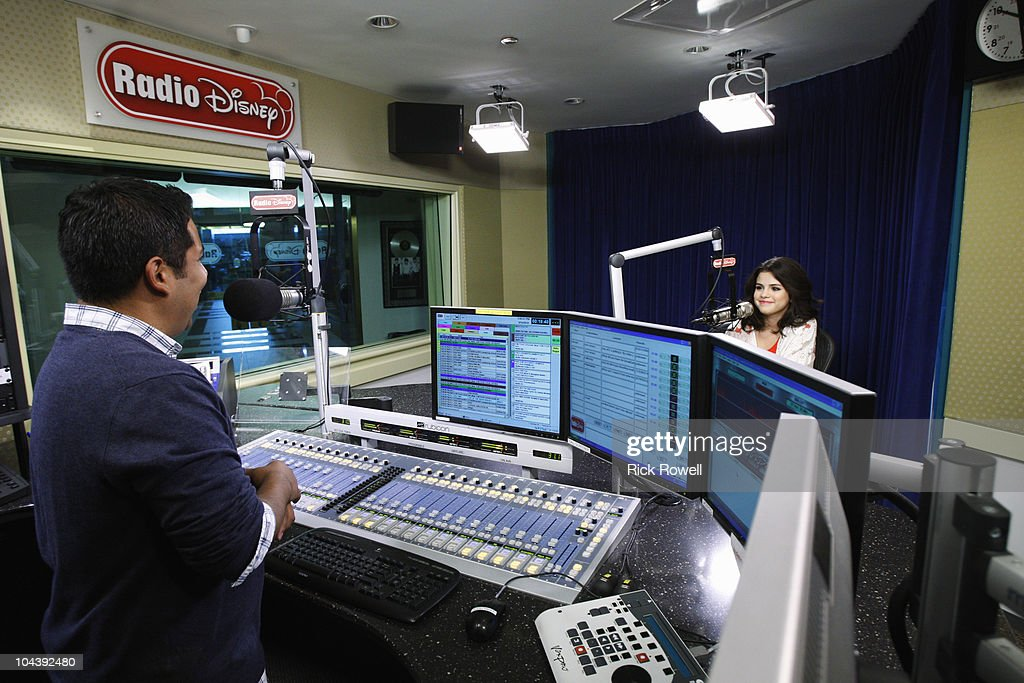DISNEY - Hollywood Records recording artist and star of 'Wizards of Waverly Place' dropped by the Radio Disney studio for a Take Over with Ernie D including an acoustic performance of her new single 'A Year Without Rain' and 'Round & Round.' (Photo by Rick Rowell/Disney Channel via Getty Images) ERNIE