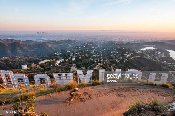 Hollywood Sign and Hikers with Los Angeles in the background
