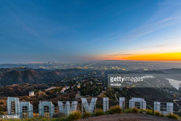 hollywood sign and los angeles looking from behind - hollywood stock pictures, royalty-free photos & images
