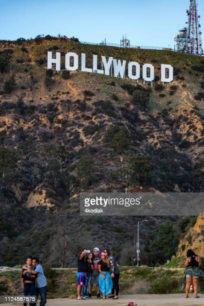 hollywood sign and tourists - hollywood boulevard stock pictures, royalty-free photos & images