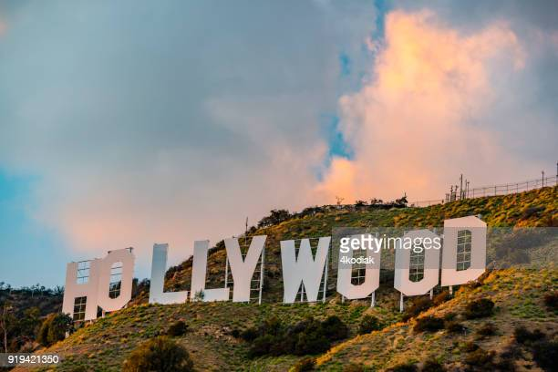 hollywood sign with sunset cloud - american animals film stock photos and pictures