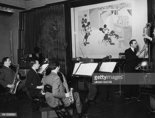 USA Hollywood Sound recording for a Mickey Mouse motion picture cartoon Walt Disney Productions Ltd Photographer Ewing Galloway Published by...