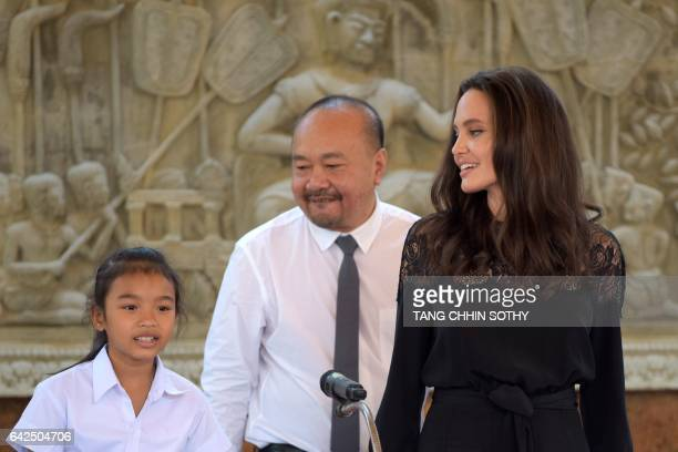 Hollywood star Angelina Jolie and Cambodian film maker Rithy Panh listen to Cambodian child actress Sareum Srey Moch during a press conference at a...