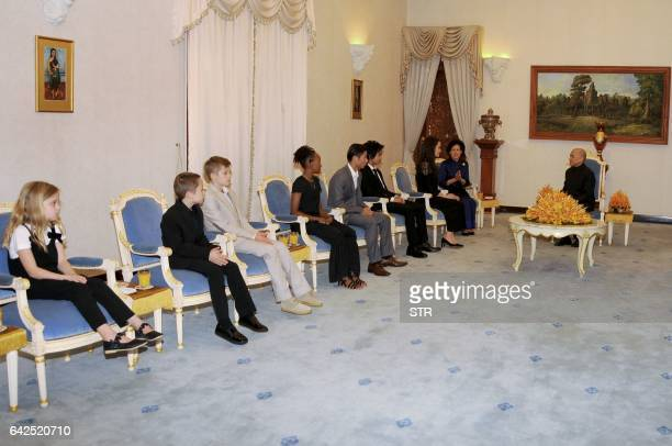 Hollywood star Angelina Jolie attends an audience with Cambodian King Norodom Sihamoni as her children look on at the royal residence in Siem Reap on...