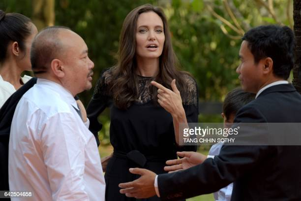 Hollywood star Angelina Jolie speaks as Cambodian film maker Rithy Panh looks on at a hotel in Siem Reap on February 18 2017 Angelina Jolie will...