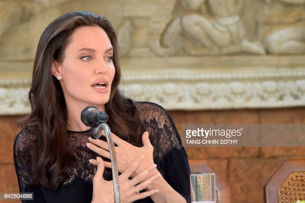 Hollywood star Angelina Jolie speaks to media during a press conference at a hotel in Siem Reap on February 18 2017 Angelina Jolie will unveil her...