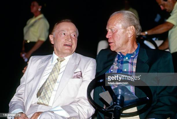 Hollywood star Bob Hope sitting with Former President Gerald R. Ford ride together in a golf cart to the stage during the annual Bing Crosby Clambake...