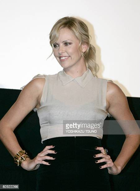 Hollywood star Charlize Theron smiles before Japanese fans during the premier of 'Hancock' at a Tokyo theater on August 23 2008 Charlize Theron and...