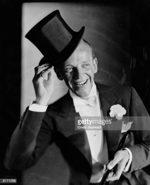 Hollywood star Fred Astaire in customary top hat and tails complete with white bow tie and carnation