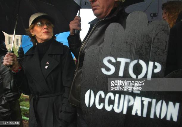 """Hollywood star Jane Fonda joins Israel's """"Women in Black"""" in an anti-occupation demonstration near the residence of Prime Minister Ariel Sharon in..."""