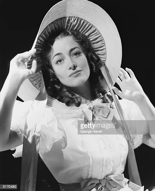 Hollywood star Joan Crawford wearing a wide brimmed bonnet for her role in 'The Gorgeous Hussy', directed by Clarence Brown for MGM.