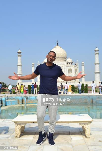 Hollywood star Will Smith gestures as he visits the Taj Mahal in Agra on October 10, 2018.