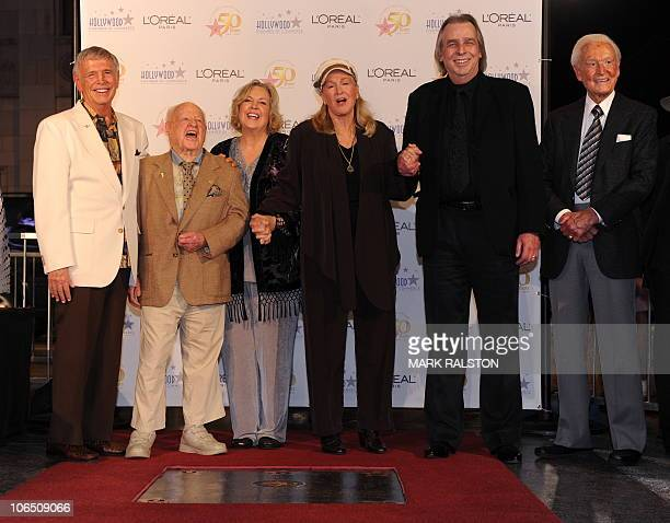 Hollywood stars and personalities Roger Williams Mickey and Jan Rooney Diane Ladd Jim Ladd and Bob barker unveil a time capsule containing Hollywood...