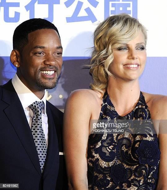 Hollywood stars Charlize Theron and Will Smith pose for photographers at the Japan premier of their latest movie Hancock at a Tokyo theater on August...