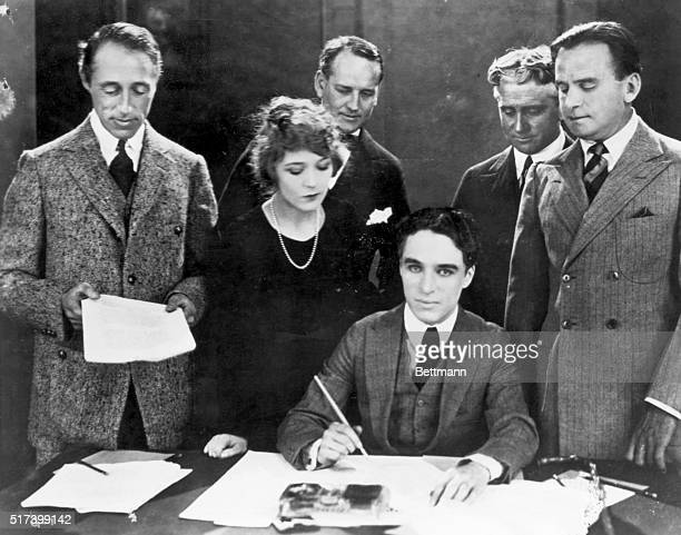 Hollywood stars D.W. Griffith, Mary Pickford, Charlie Chaplin, and Douglas Fairbanks at a United Artists contract signing.