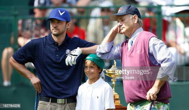 Hollywood stars Justin Timberlake and Bill Murray wait with Sean Lehman on the first tee during the 2012 Ryder Cup Captains Celebrity Scramble at...