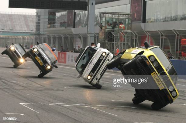 A Hollywood stunt actor performs atop a car driving through fire at the Shanghai International Circuit on March 12 in Shanghai China The Hollywood...