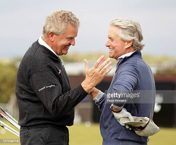 Hollywood superstar Michael Douglas talks with Colin Montgomerie of Scotland on the practice range during the first practice round of The Alfred...